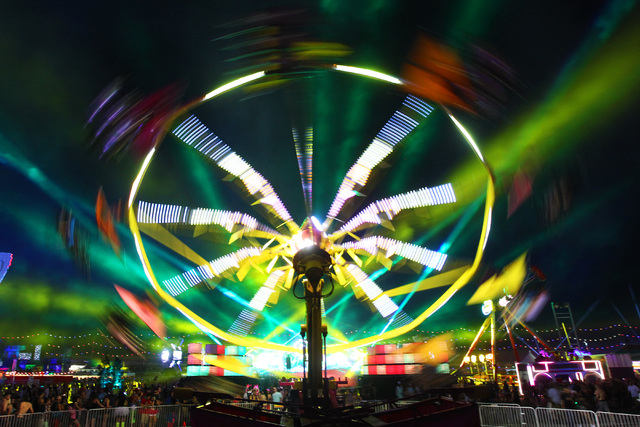 Lasers light up the sky as an amusement ride spins during the first night of the Electric Daisy Carnival Saturday, June 20, 2015 at the Las Vegas Motor Speedway. (Sam Morris/Las Vegas Review-Journ ...