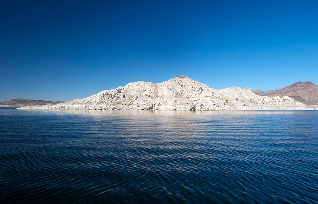 White, chalky residue covers a hill that was once submerged on Lake Mead in 2013. (Las Vegas Review-Journal)