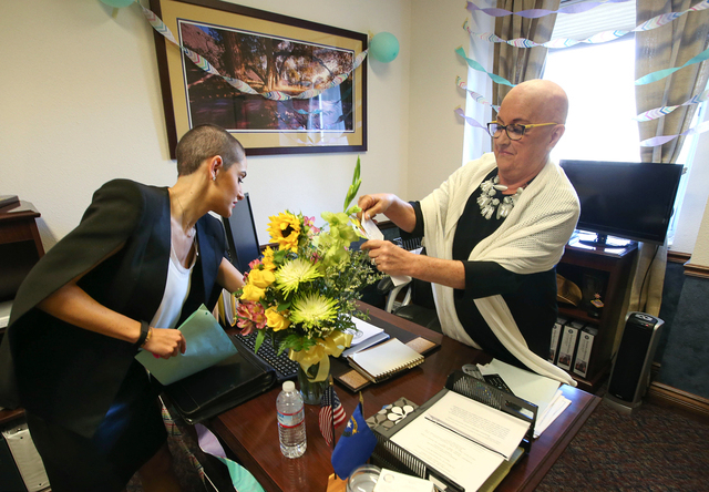 Nevada Sen. Debbie Smith, D-Sparks, and her daughter, Erin Smith Marlo, look through gifts left in her office in the Legislative Building in Carson City on Wednesday, April 8, 2015. Smith returned ...