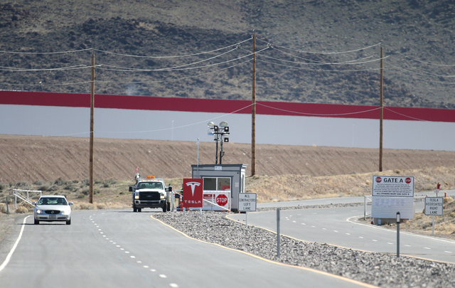 Traffic moves through the Tesla main gate at the Reno Tahoe Industrial Center, east of Reno on Monday, Feb. 29, 2016. Approximately 300 construction workers walked off the job Monday claiming a co ...
