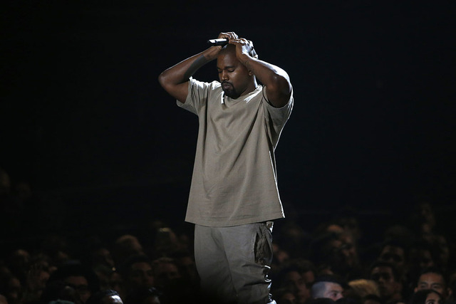 Kanye West pauses as he speaks at the Video Vanguard Award at the 2015 MTV Video Music Awards in Los Angeles, California, in this August 30, 2015 file photo. West, who says he is $53 million in de ...