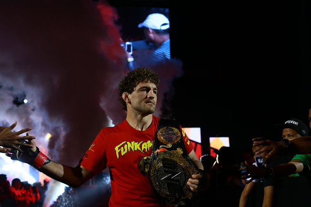 ONE Championship welterweight champion Ben Askren walks out to the cage to defend his title against Luis Santos on April 24 in Pasay, Philippines. The bout ended in a no-contest when Santos couldn ...