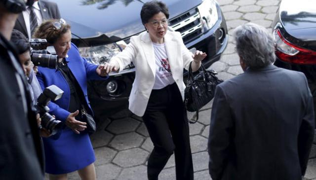 World Health Organization (WHO) Director-General Margaret Chan (C) greets Oswaldo Cruz Foundation President Paulo Gadelha during a visit to the Oswaldo Cruz Foundation in Rio de Janeiro, Brazil, F ...