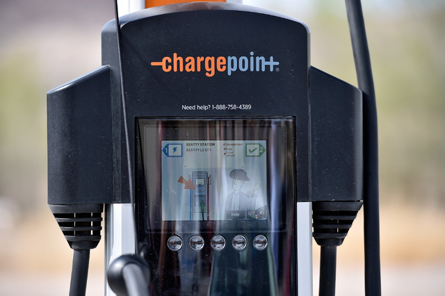 An electric vehicle charger is seen during the dedication of the first electric car charging station along U.S. Highway 95 on Tuesday, March 1, 2016, in Beatty. The station is the fist of many pla ...