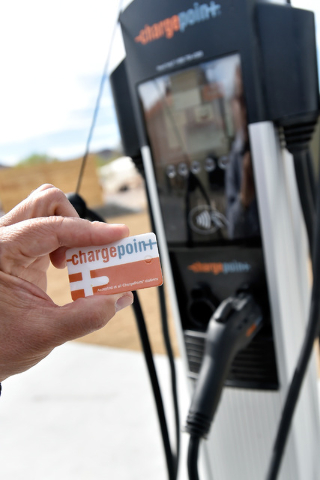 A ChargePoint card is used during the dedication Tuesday. The station is the first of many planned. David Becker/Las Vegas Review-Journal Follow @davidjaybecker