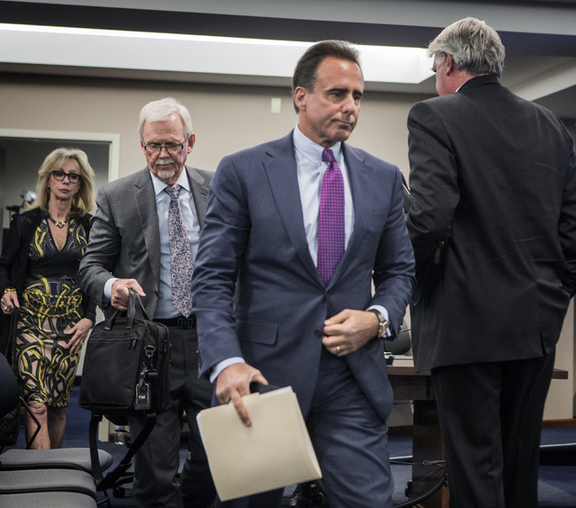 Caesars Entertainment CEO Mark Frissora, right, his attorney Frank Schreck and Jan Jones Blackhurst, vice president of government relations and corporate responsibility for Caesars Entertainment,  ...