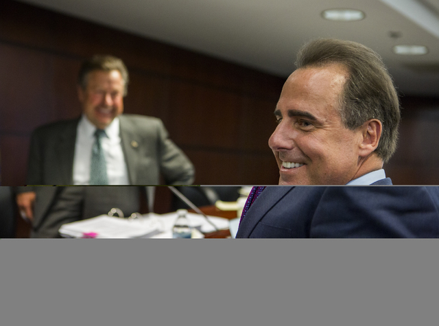Caesars Entertainment President and CEO Mark Frissora, right, smiles while talking to Nevada Gaming Commissioner Randolph Townsend, not shown, and commissioner John Moran Jr. and after he was appr ...