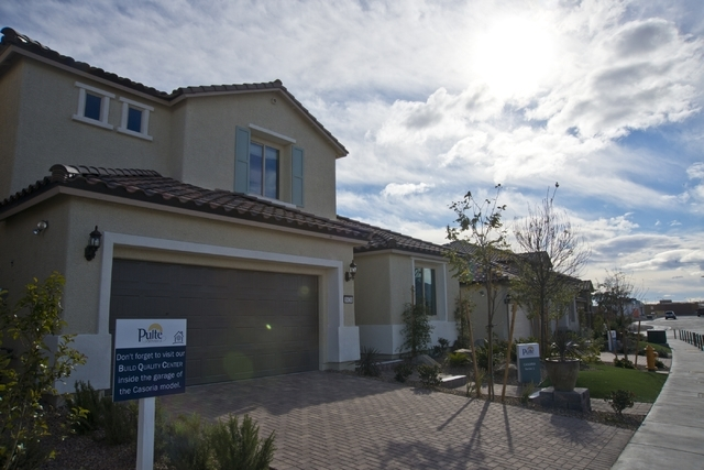 Model homes are seen inside the Evergreen subdivision of the Skye Canyon master-planned community off U.S. Highway 95 at Skye Canyon Drive in northwest Las Vegas on Monday, Dec. 14, 2015. Daniel C ...