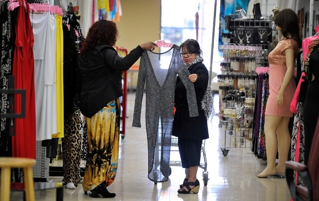 Cheryl Banks, left, displays a dress to customer Connie Santana in her clothing boutique, CR Fashionz, at the Tropicana Discount Mall Monday, Jan. 11, 2016, in Las Vegas. David Becker/Las Vegas Re ...