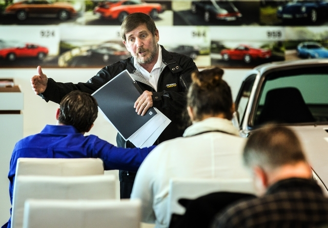 Grant Blakeman, director of regional sales at SpeedVegas, talks to a job applicant during the SpeedVegas job fair at Gaudin Porsche of Las Vegas, 6800 Redwood Street, on Tuesday, Jan. 12, 2016. Th ...