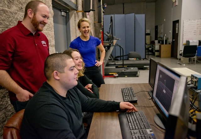 From left, Jeff Eggleston, John Harry, Kristy Wiegand and Sophia Bradley watch a video created with a motion capture system inside the Sports Injury Research Center at UNLV Jan. 22. Daniel Clark/L ...