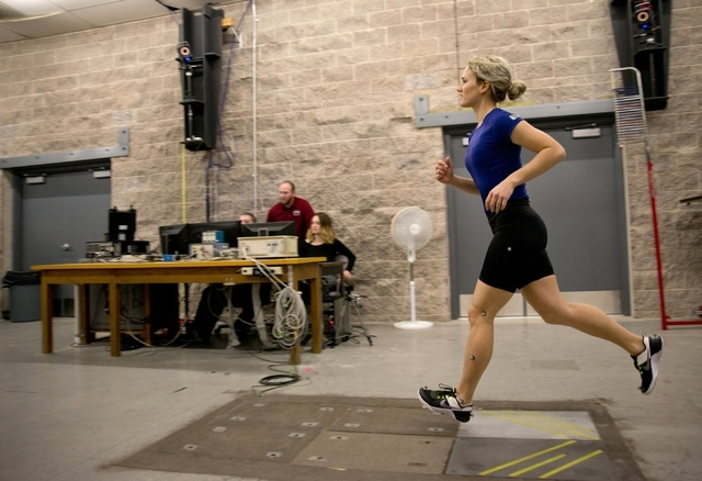 Sophia Bradley runs as a 10-camera motion capture system tracks her movements inside the Sports Injury Research Center in the Paul McDermott Physical Education Complex on the UNLV campus Jan. 22.  ...