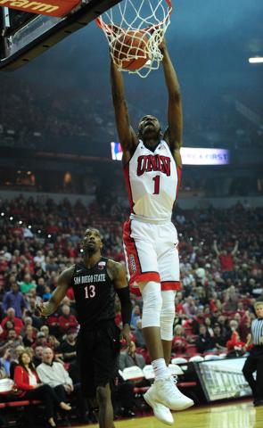 UNLV forward Derrick Jones Jr. (1) dunks against San Diego Sate in the first half of their NCAA college basketball game at the Thomas & Mack Center in Las Vegas Saturday, Jan. 30, 2016. (Josh  ...