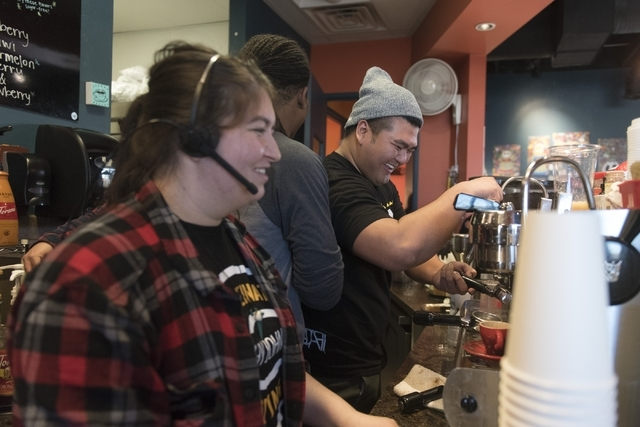 From left, Destiny Gray, Jay White and J.R. Rose prepare orders at Grouchy John's Coffee, 8520 S. Maryland Parkway, Feb. 5. Jason Ogulnik/Las Vegas Review-Journal