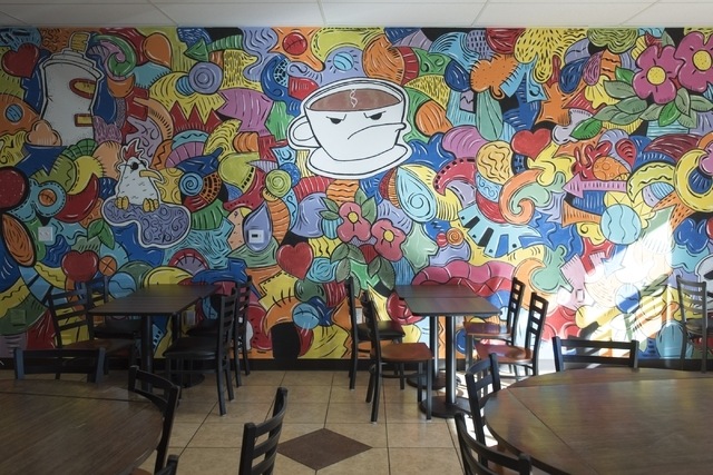 A mural covers one wall of the back dining area at Grouchy John's Coffee, 8520 S. Maryland Parkway. Jason Ogulnik/Las Vegas Review-Journal