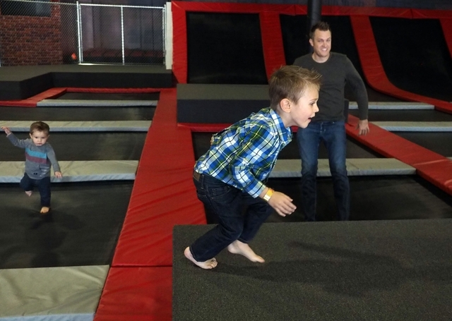 Ryan Kissling of Las Vegas watches his sons, Conner, left, 18 months, and Colton, 4, during their first visit Feb. 10 to Flipnout Xtreme Las Vegas Trampoline Park, 4245 S. Grand Canyon Drive, Suit ...