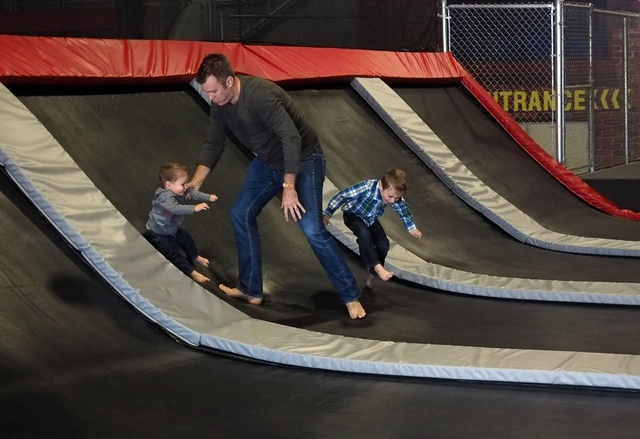 Ryan Kissling plays with his sons, left, Conner, 18 months, and Colton, 4, during their first visit Feb. 10 to Flipnout Xtreme Las Vegas Trampoline Park, 4245 S. Grand Canyon Drive, Suite 111. Jer ...