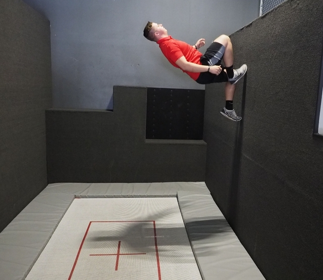 Chase Spendlove, 17, a shift supervisor at Flipnout, demonstrates wall walking Feb. 10 at the trampoline park, 4245 S. Grand Canyon Drive, Suite 111. Jerry Henkel/View