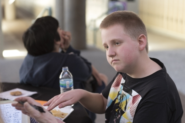 Sixth-grader Colin Wyrsch speaks with a reporter during lunch break on No One Eats Alone Day Feb. 12 at Becker Middle School. The initiative aims to end social isolation in schools. Jason Ogulnik/View