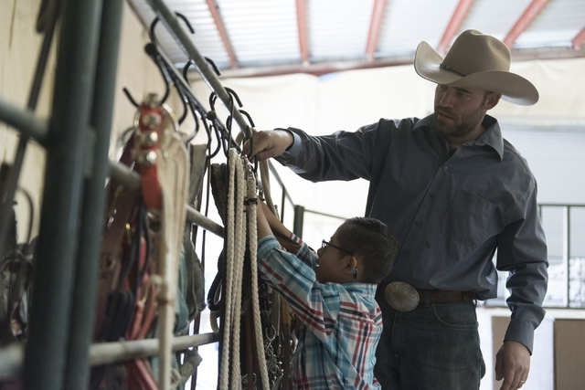 Paul Rogers, co-owner of Paradise Ranch, right, and 8-year-old Diego Diaz return stirrups to their proper place at the end of Diaz's horse-assisted therapy session at the ranch at 1722 Primrose Pa ...