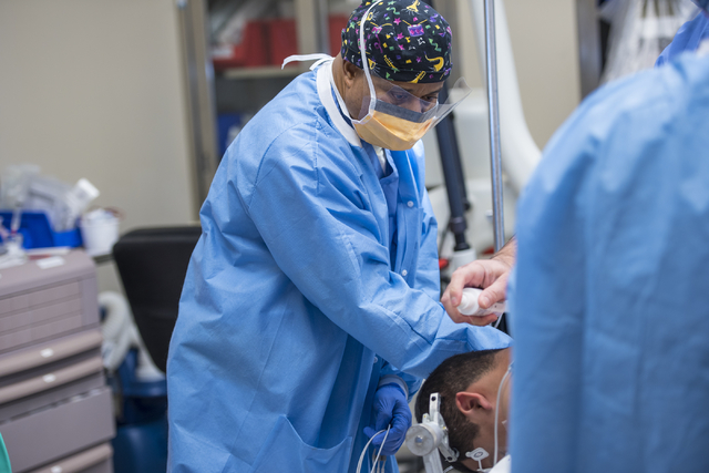 Samson Otuwa, physician anesthesiologist, preps a patient for surgery at University Medical Center in Las Vegas on Friday, Feb. 12, 2016. Joshua Dahl/Las Vegas Review-Journal