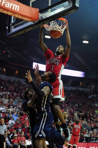 UNLV forward Derrick Jones Jr. (1) dunks against UNR in the first half of their NCAA college basketball game at the Thomas & Mack Center in Las Vegas Saturday, Feb. 20, 2016. UNLV defeated UNR ...