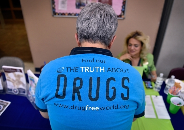 A man looks over one of the vendor tables during There is No Hero in Heroin Foundation's Black Monday event at The Salvation Army Chapel Feb. 15. David Becker/View