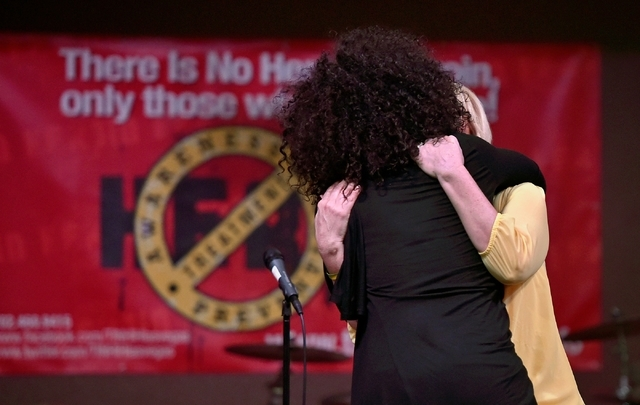 Recovering alcoholics Nyla Christian, left, and Heather Frost hug after they each spoke during There is No Hero in Heroin Foundation's Black Monday event at The Salvation Army Chapel Feb. 15. Davi ...
