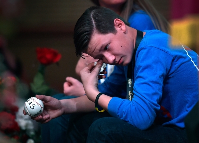 Lucas Vandever wipes his eyes during a presentation about his older brother, Nick Vandever, during There is No Hero in Heroin Foundation's Black Monday event at at The Salvation Army Chapel Feb. 1 ...