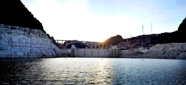 Hoover Dam and the Mike O'Callaghan-Pat Tillman Memorial Bridge is seen at sunset during the annual eagle count at Lake Mead on Tuesday, Jan. 12, 2016. As a long-term drought continues, a white &a ...