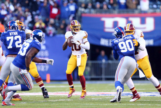 Dec 14, 2014; East Rutherford, NJ, USA; Washington Redskins quarterback Robert Griffin III (10) drops back to pass against the New York Giants during the third quarter of a game at MetLife Stadium ...