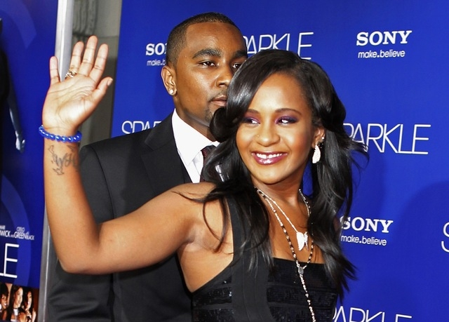 "Bobbi Kristina Brown waves as she and boyfriend Nick Gordon arrive at the premiere of the new film ""Sparkle"" in Hollywood, Aug. 16, 2012. Brown, daughter of late pop star Whitney Houston and singe ..."