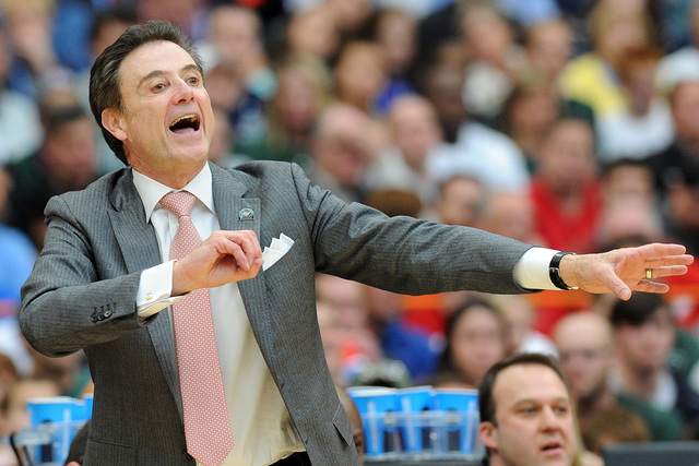 Mar 29, 2015; Syracuse, NY, USA; Louisville Cardinals head coach Rick Pitino reacts to a play during the second half against the Michigan State Spartans in the finals of the east regional of the 2 ...