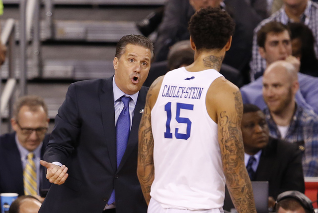 Kentucky Wildcats head coach John Calipari speaks with forward Willie Cauley-Stein (15) during the first halfof the 2015 NCAA Men's Division I Championship semi-final game against the Wisconsin Ba ...