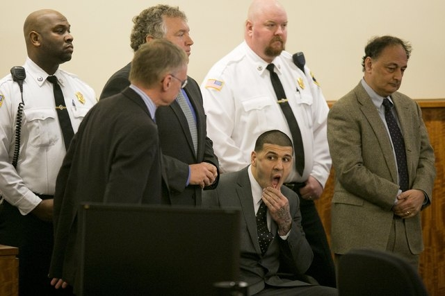 Former NFL player Aaron Hernandez awaits the verdict during his murder trial at the Bristol County Superior Court in Fall River, Massachusetts, April 15, 2015. Hernandez, 25, a former tight end fo ...