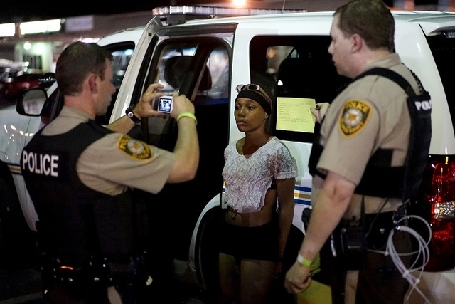 Police take a mug shot of a protester who was detained in Ferguson, Missouri, in this August 10, 2015 file photo. (REUTERS/Rick Wilking/Files)