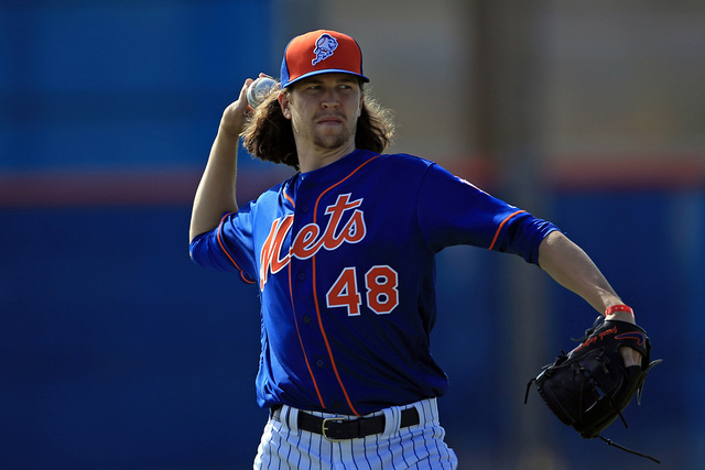 Feb 19, 2016; Port St. Lucie, FL, USA; New York Mets starting pitcher Jacob deGrom (48) takes infield practice at Tradition Field. (Steve Mitchell/USA TODAY Sports)