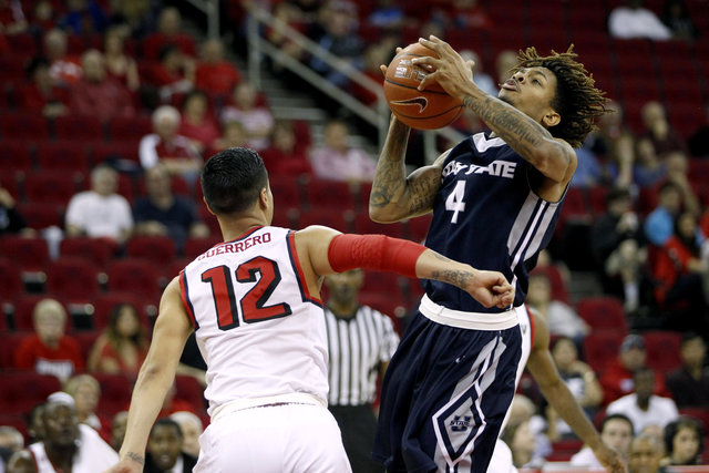 Feb 20, 2016; Fresno, CA, USA; Utah State Aggies guard Shane Rector (4) shoots the ball over Fresno State Bulldogs guard Cezar Guerrero (12) in the first half at the Save Mart Center. (Cary Edmond ...