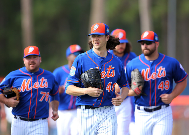 Feb 22, 2016; Port St. Lucie, FL, USA; New York Mets starting pitcher Jacob deGrom (48) leads a group of pitchers during spring training work out drills at Tradition Field. (Steve Mitchell/USA TOD ...
