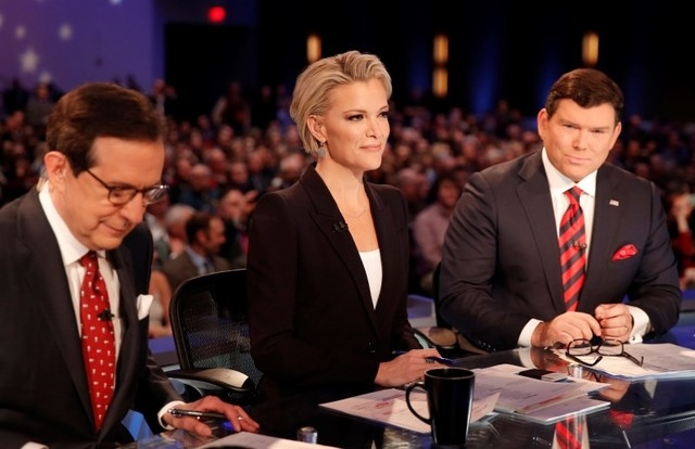 Fox News Channel anchors and debate moderators Chris Wallace, left, Megyn Kelly and Bret Baier begin the debate held by Fox News for the top 2016 Republican presidential candidates in Des Moines,  ...