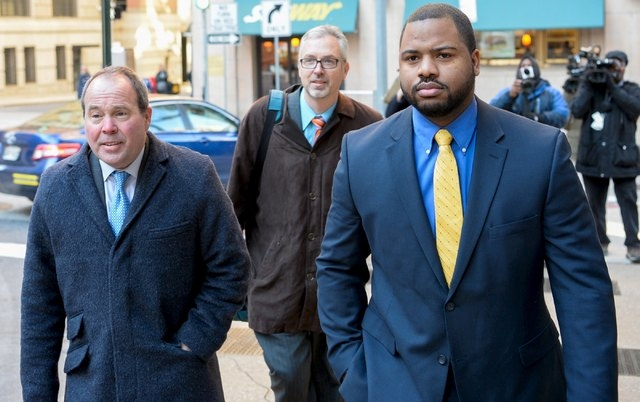 Baltimore police officer William Porter, right and his attorneys, Joseph Murtha, left, and Gary Proctor arrive at the courthouse for pretrial hearings in the case of Caeser Goodson in Baltimore, J ...