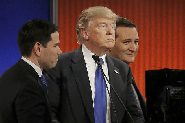 Republican U.S. presidential candidate Donald Trump (C) talks with rival candidates Marco Rubio (L) and Ted Cruz (R) at the conclusion of the U.S. Republican presidential candidates debate in Detr ...