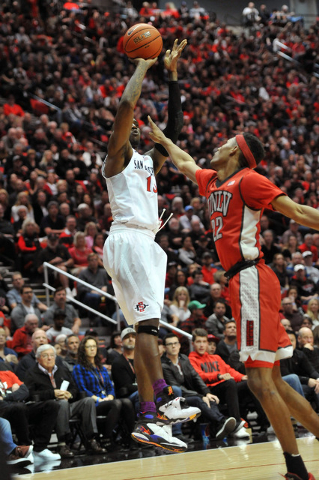 Mar 5, 2016; San Diego, CA, USA; San Diego State Aztecs forward Winston Shepard (13) shoots over UNLV Rebels guard Patrick McCaw (22) during the first half at Viejas Arena at Aztec Bowl. Mandatory ...