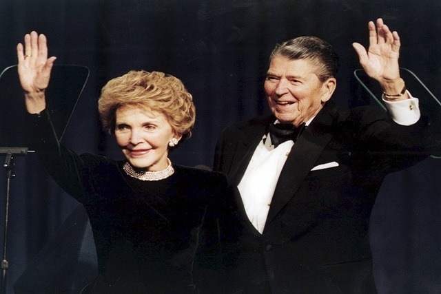 Former U.S. President Ronald Reagan and his wife Nancy wave while attending a gala celebrating his 83rd birthday in Washington in this  February 3, 1994 file photo. (REUTERS/Mike Theiler/Files)
