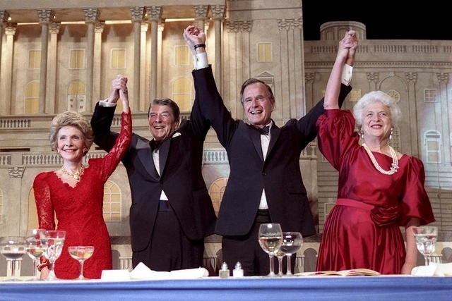 U.S. President Ronald Reagan (2nd L) and Vice President George Bush (2nd R), accompanied by their wives Nancy (L) and Barbara respectively, join hands after Reagan endorsed Bush's run for the pres ...
