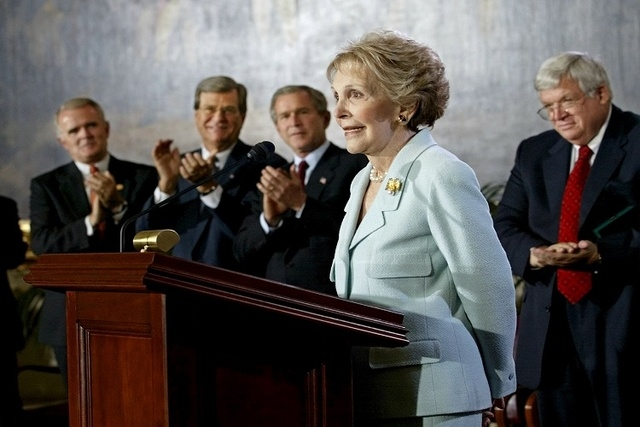 Former U.S. first lady Nancy Reagan receives a standing ovation during a Congressional Gold Medal ceremony at the U.S. Capitol in this May 16, 2002 file photo. (REUTERS/Win McNamee/Files)