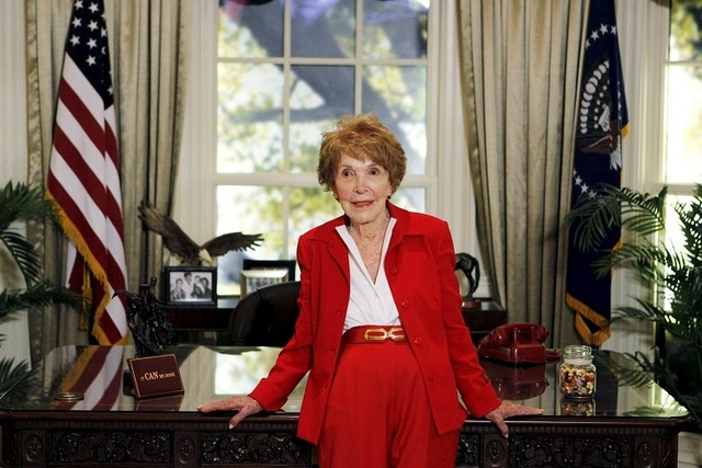 Former U.S. first lady Nancy Reagan waits to greet Republican presidential candidates in a replica of the Oval Office at the Ronald Reagan Presidential Library in Simi Valley, California in this S ...