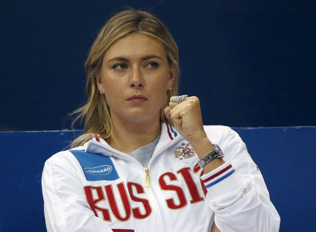 Russia's Maria Sharapova reacts as she watches compatriot Ekaterina Makarova play against Kiki Bertens of the Netherlands during their Fed Cup World Group tennis match in Moscow, February 6, 2016. ...
