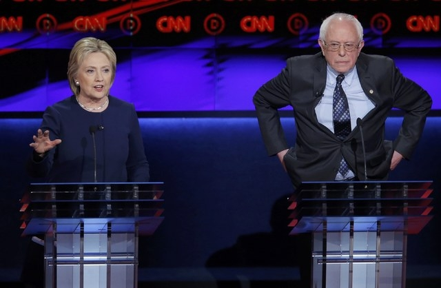 Hillary Clinton speaks as rival Bernie Sanders listens at the Democratic U.S. presidential candidates' debate in Flint, Mich., on Sunday. (REUTERS/Jim Young)