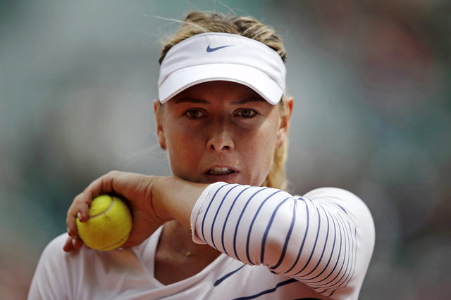 Maria Sharapova of Russia wipes her face during her women's singles match against Lucie Safarova of the Czech Republic during the French Open tennis tournament at the Roland Garros stadium in Pari ...